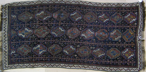 Afshar throw rug, ca. 1910, with repeating medalli