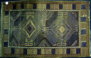 Two Beluch throw rugs, together with a Bokhara and