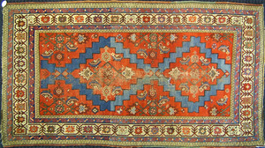 Two semi-antique throw rugs, 6'4