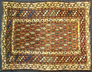Kurdish throw rug, ca. 1920, with boteh design on