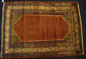 Malayer throw rug, ca. 1910, with boteh design on