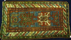 Lesghi star throw rug, ca. 1910, with blue field a