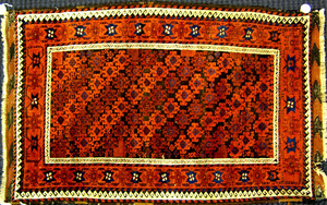 Beluch throw rug, ca. 1890, with repeating medalli