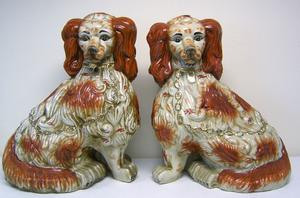 Pair of massive porcelain spaniels, 20th c., 23 1/