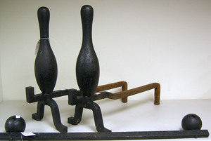 Pair of cast iron bowling pin andirons, 20th c., 2