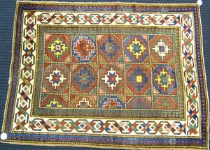 Moghan Kazak throw rug, ca. 1900, with repeating m