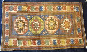 Kazak throw rug, ca. 1910, with 4 medallions on al