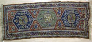 Sumak throw rug, ca. 1910, with 3 central medallio