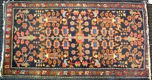 Three semi-antique oriental mats, largest - 4'3
