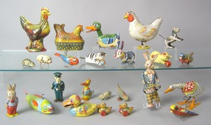 Twenty-two painted tin animal toys, early/mid 20th
