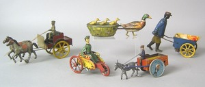 Five painted tin cart toys, early 20th c., to incl