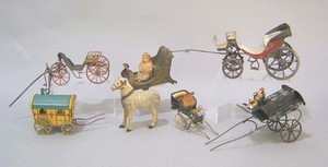 Seven tin cart and carriage toys, early /mid 20th.