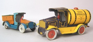 Two Strauss painted tin trucks, ca. 1920's, to inc