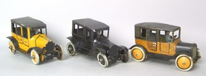Two painted tin Yellow taxis, ca. 1930, together w