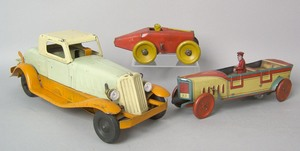 Three painted tin automotive toys, 1920's/1930's t