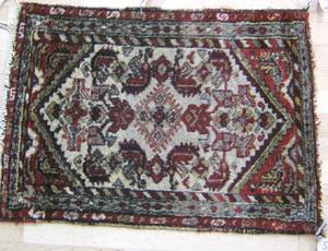 Three oriental mats, ca. 1940, 5'2