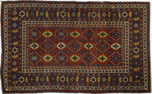 Shirvan throw rug, ca. 1910, with overall floral d
