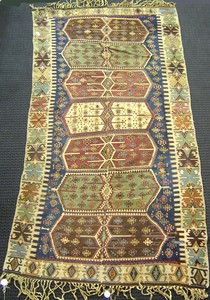 Kilim rug, ca. 1920, with 7 medallions on a blue f