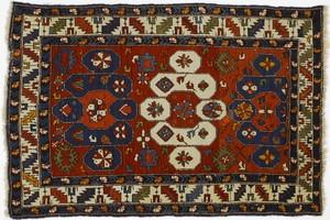 Caucasian throw rug, ca. 1910, with 3 medallions o