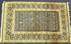 Sejshour throw rug, ca. 1900, with overall medalli