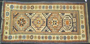 Kazak throw rug, ca. 1910, with 4 medallions on aa