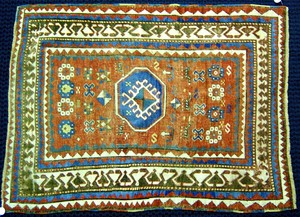 Kazak throw rug, ca. 1910, with red field and sawt