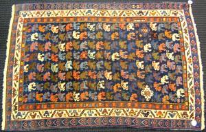 Kuba throw rug, ca. 1915, with navy field and ivor