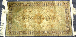 Qum mat, ca. 1950, with overall floral design on a