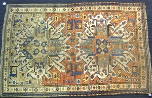 Eagle Kazak throw rug, ca. 1910, with 2 medallions