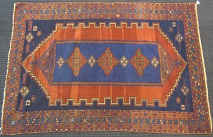 Kazak throw rug, ca. 1900, with central navy medal