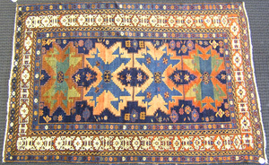Leshgi star throw rug, ca. 1900, with 4 medallions