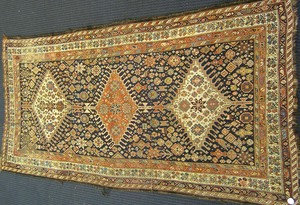 Kashgai long rug, ca. 1900, with 3 central medalli