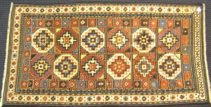 Moghan Kazak throw rug, late 19th c., with 12 meda