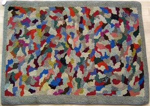 Two American hooked rugs with abstract designs, 70