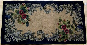 Three American hooked rugs with floral decoration,