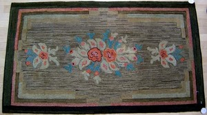 Two American hooked rugs with floral decoration, 6