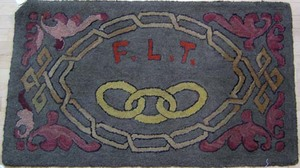 American fraternal hooked rug with chain links & i