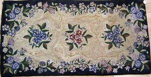 Two American hooked rugs with floral decoration, t