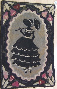 Three American hooked rugs, early 20th c.,one with