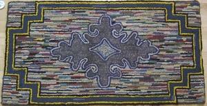Three American hooked rugs with geometric decorati