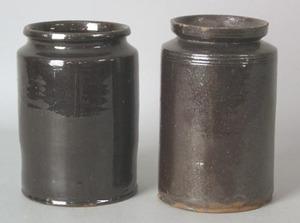 Two similar redware crocks, 19th c., with manganes