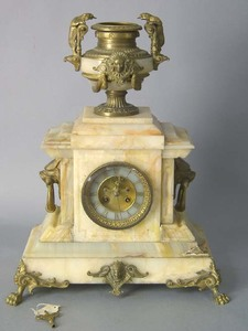 Victorian marble and ormolu mantle clock with lion