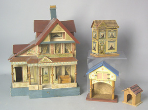 Four doll house's to include a carved and paintedo