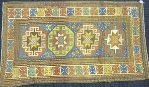 Moghan Kazak throw rug, ca. 1900, with 4 central m