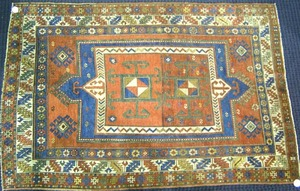 Kazak throw rug, ca. 1900, with central red medall