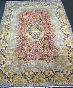 Roomsize Kirman rug, ca. 1930, with central blue a