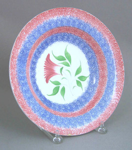 Blue and red rainbow spatter soup bowl with red th