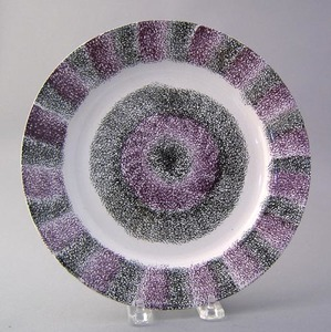 Vibrant black and purple rainbow spatter plate wit
