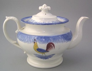 Blue spatter teapot with yellow, blue, and red roo