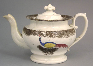 Brown spatter teapot with blue, yellow, and red do